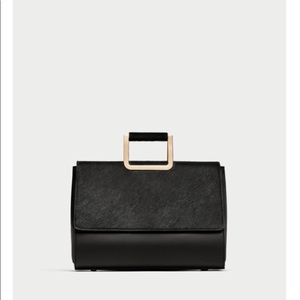 Zara faux fur front city bag.